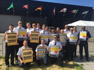 Atlas pilots protest at a shareholder meeting of customer Amazon in May 2019